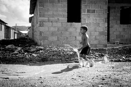 boy playing in mud