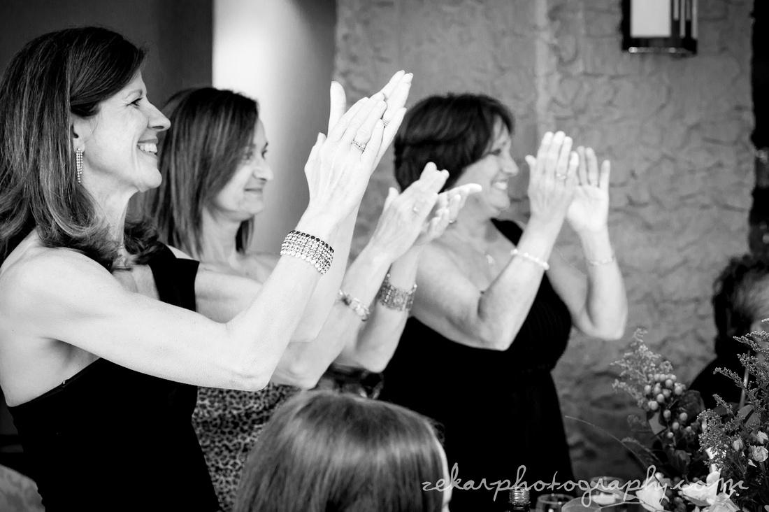 guests applauding bride and groom