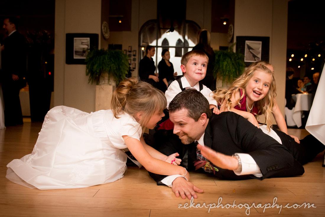kids jumping on groom