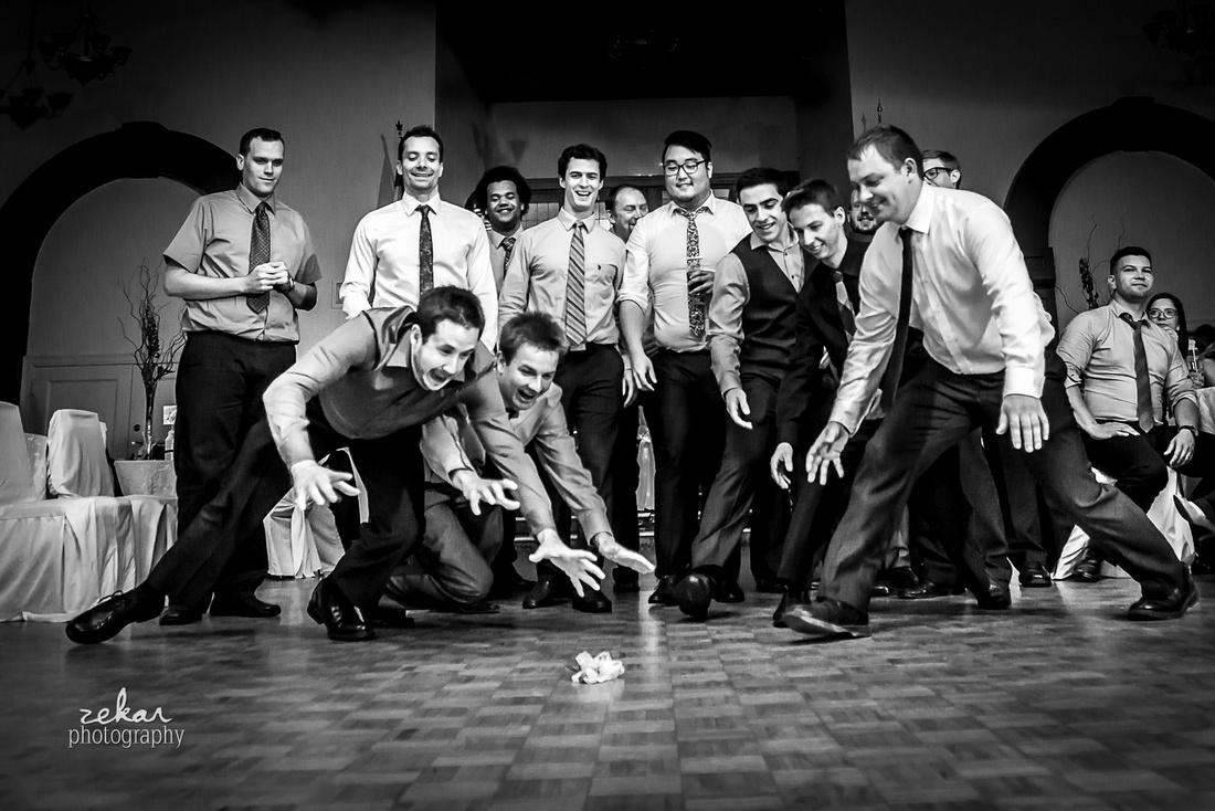 groomsmen fighting over garter toss