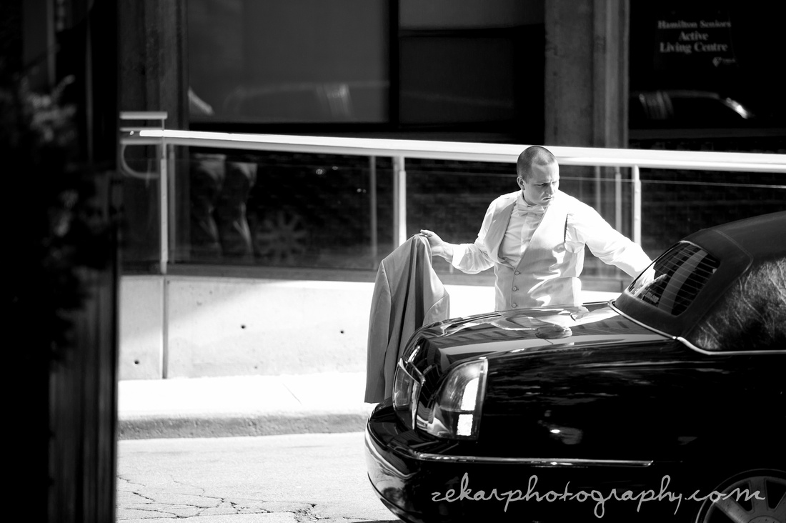 groom getting out of limousine