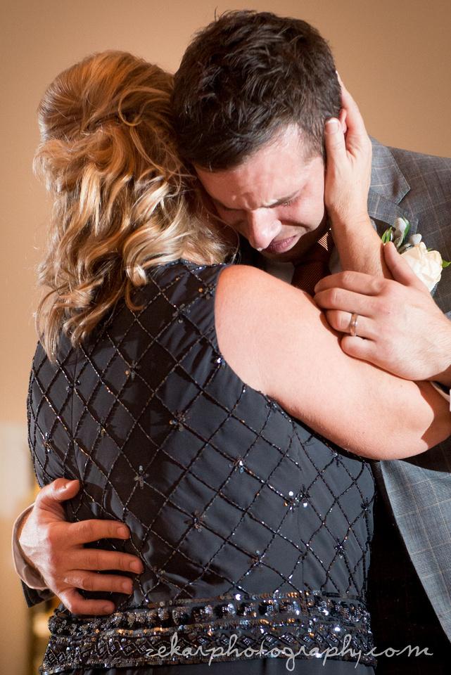 groom crying dancing with mom