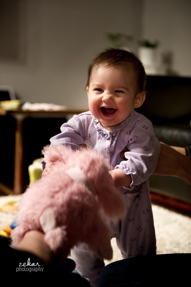 baby laughing at puppet