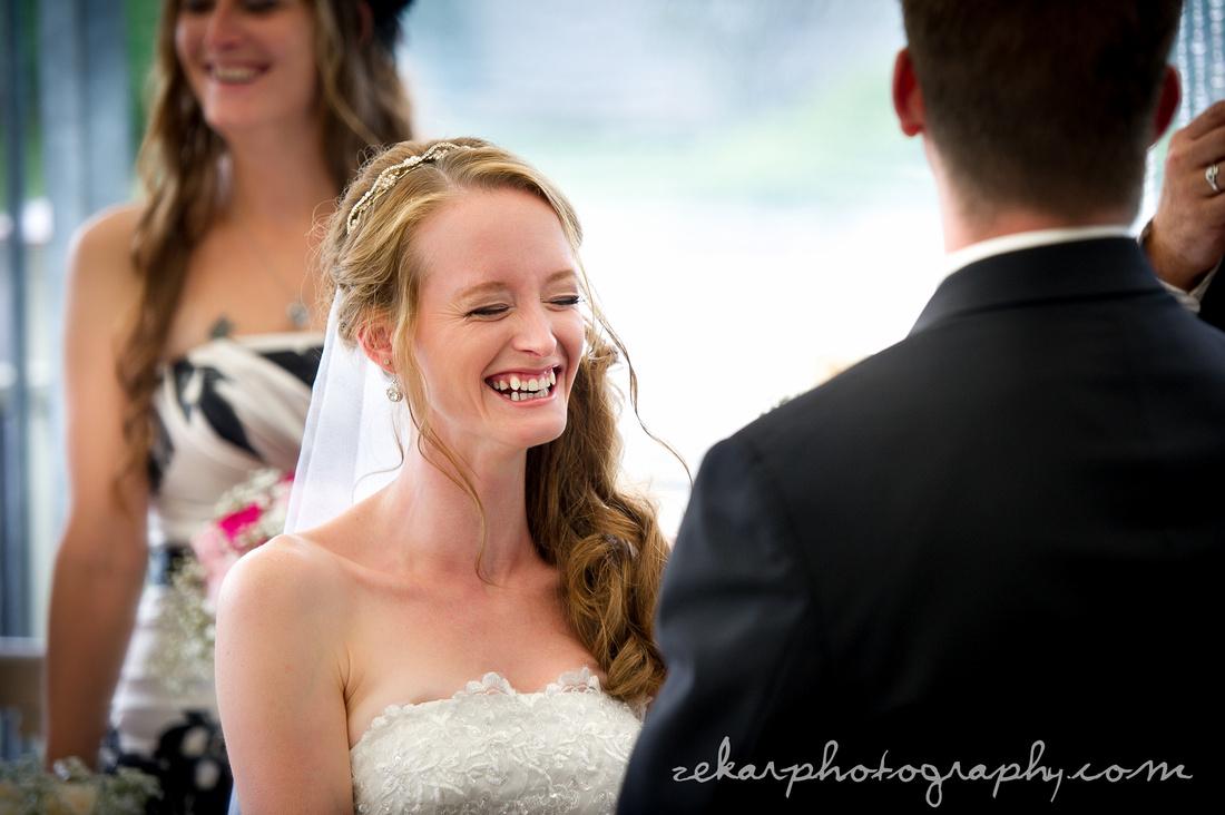 bride smiling at altar