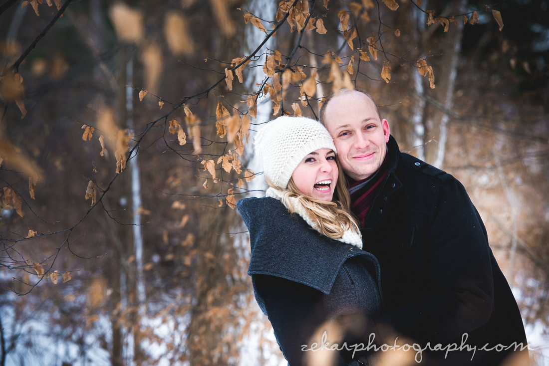 couple laughing in snow engagement session