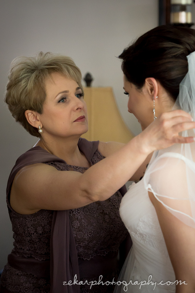 mother of bride putting on veil