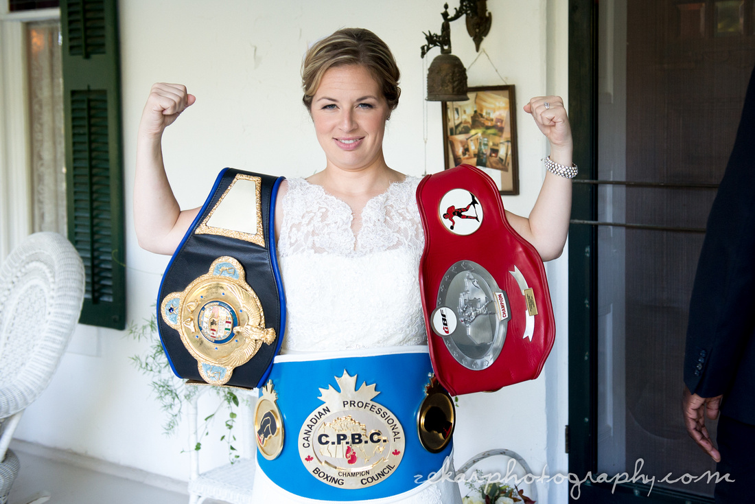 bride with boxing championship belts