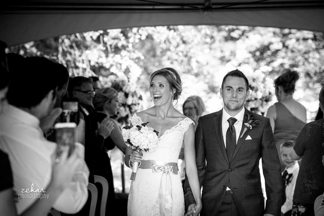 bride and groom coming down aisle