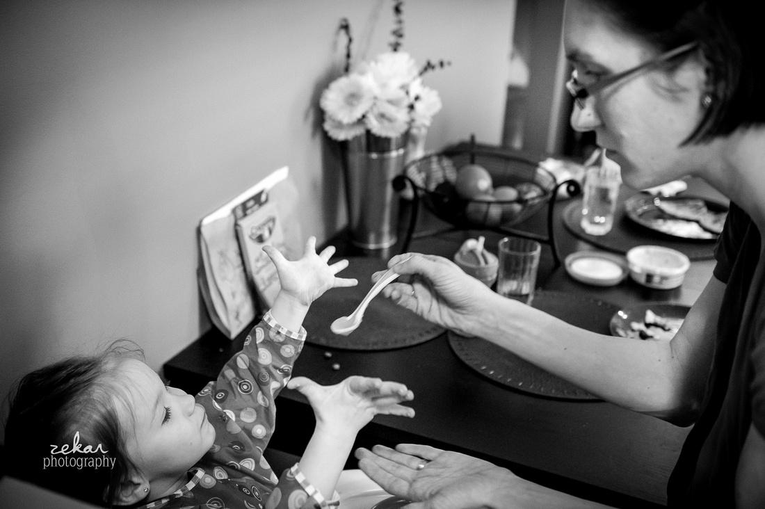 mom feeding baby girl