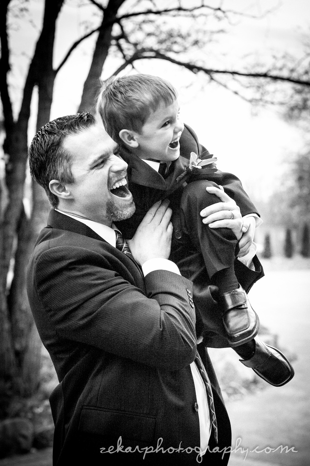 black and white photo of groom with ring bearer