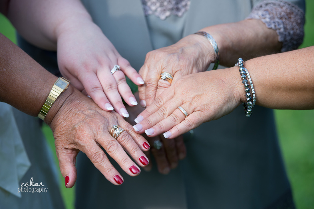 four generations of hands with rings