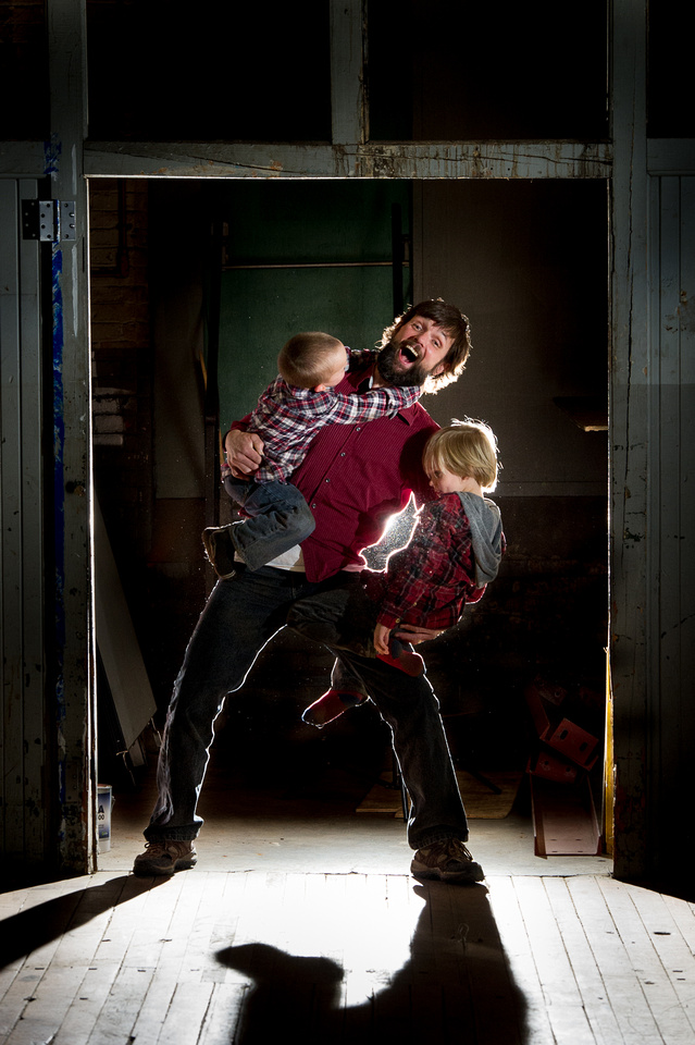 dad wrestling with sons