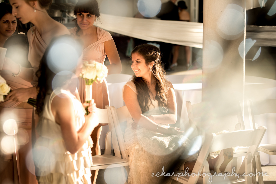 bride smiling at bridesmaids