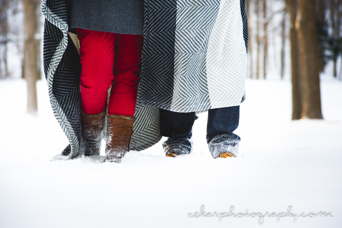 couples feet in snow