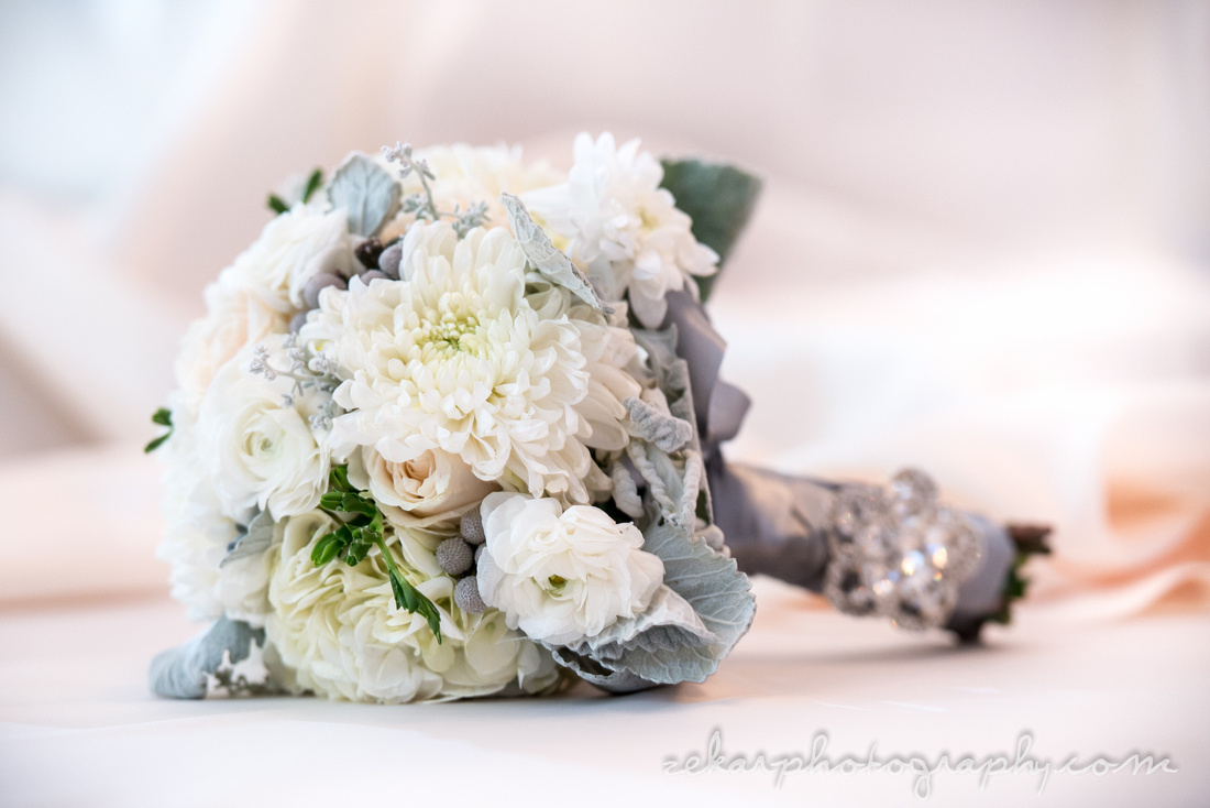 winter wedding floral bouquet dusty miller peonies champagne roses