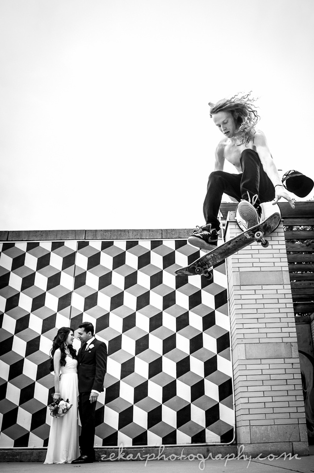 bride and groom black and white photo with skateboarder