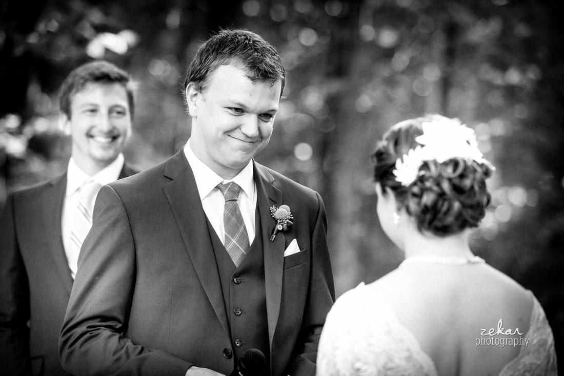 groom looking at bride altar