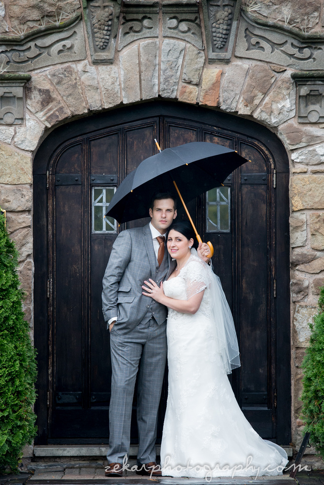 handsome couple standing in the rain