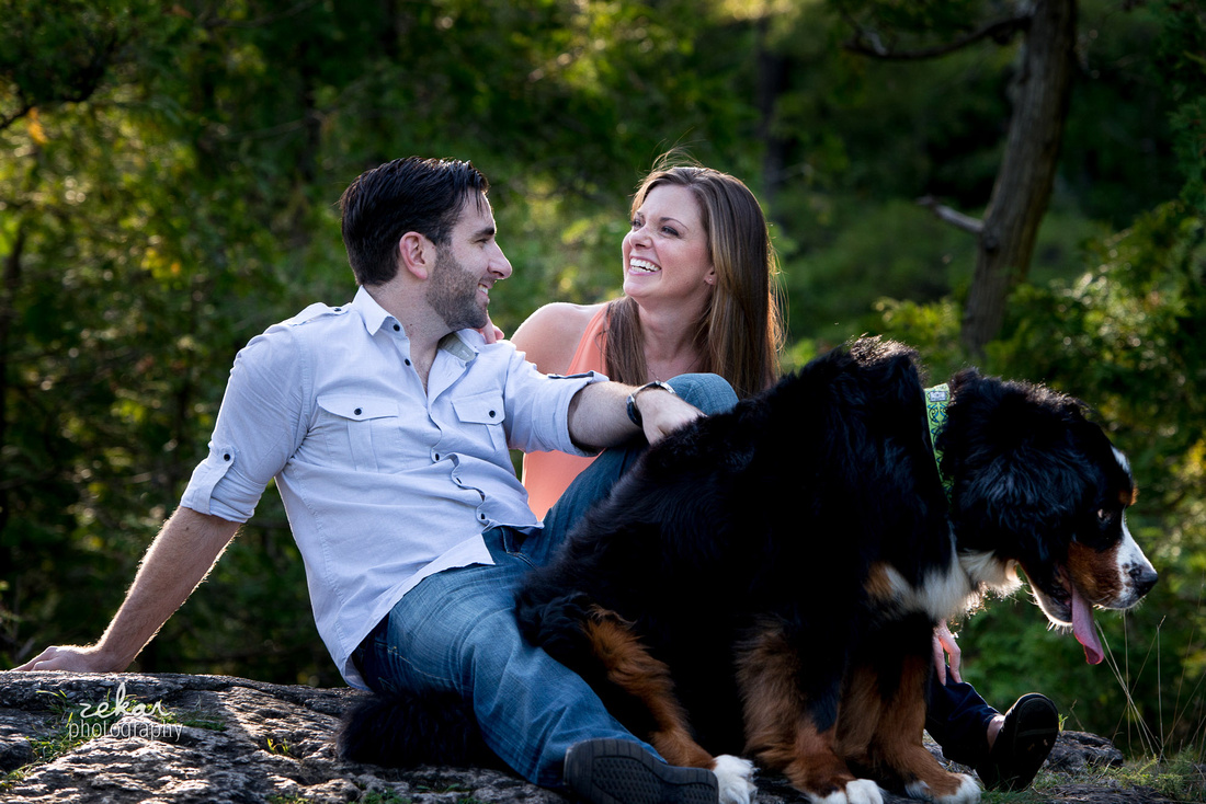couple laughing with dog