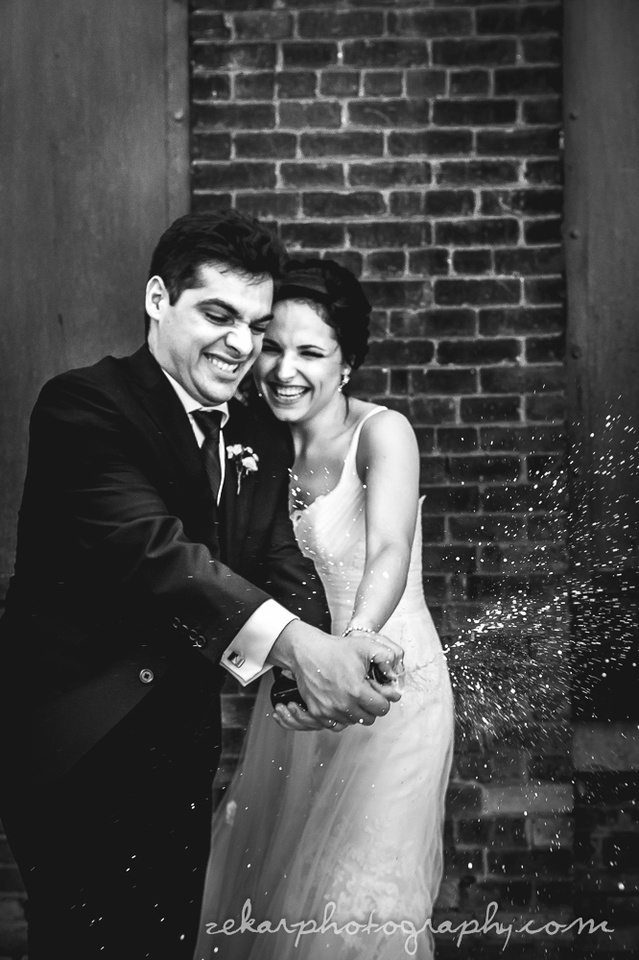 bride and groom black and white champagne spray