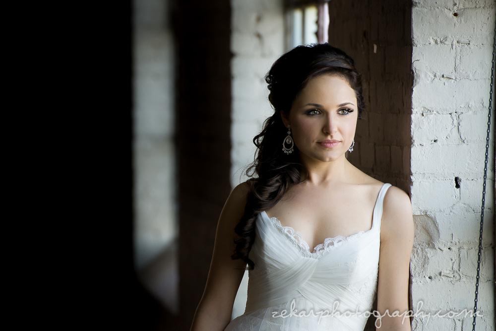 beautiful bride standing by window