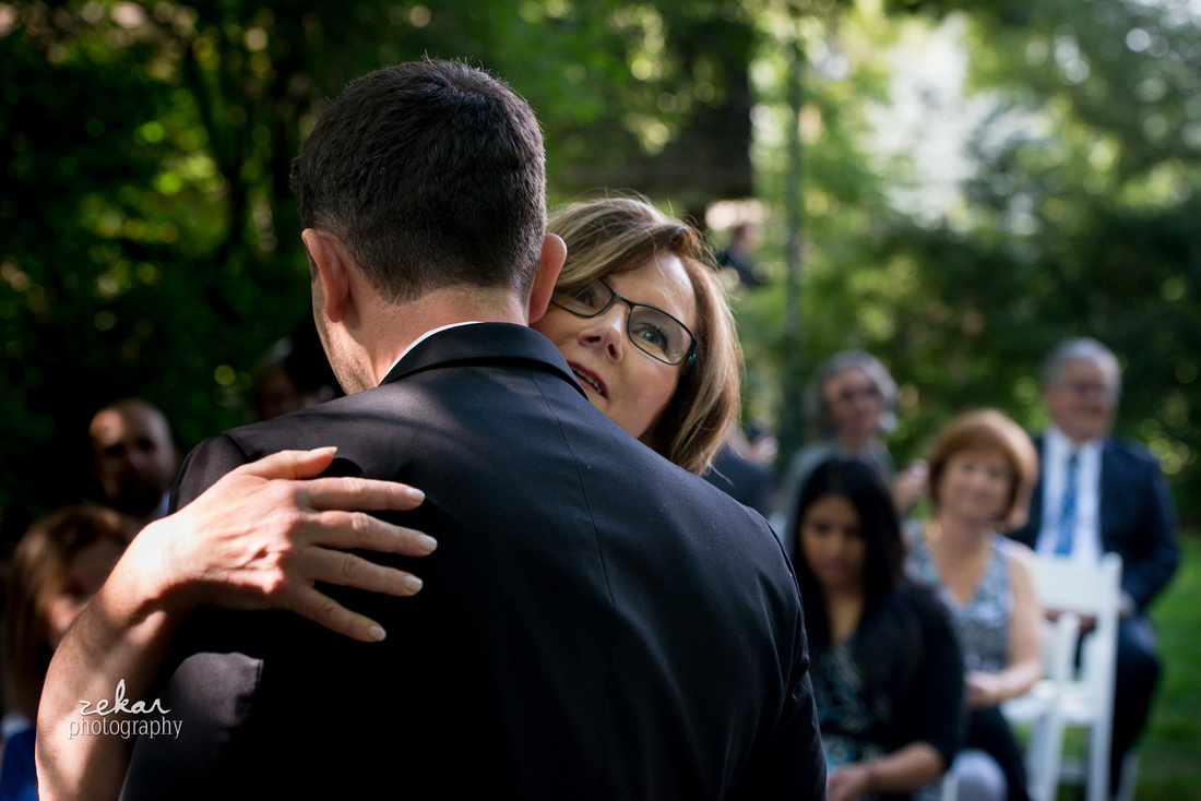 groom hugging mom
