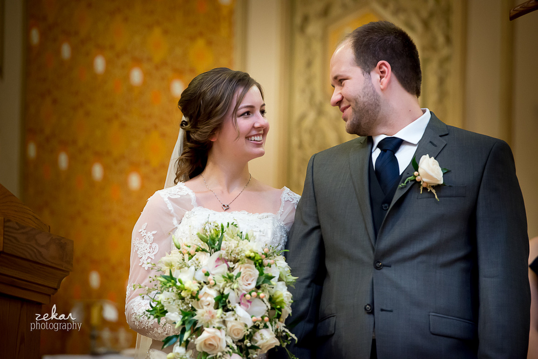 bride and groom at wedding ceremony smiling