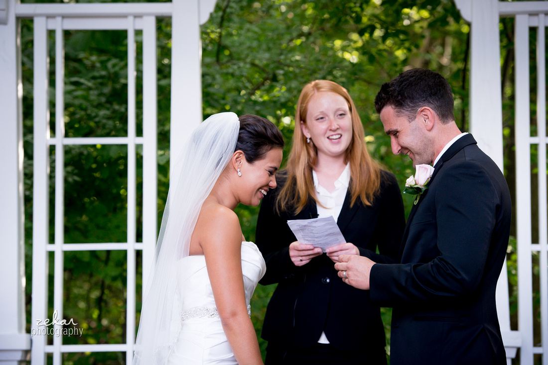 bride and groom laughing at ceremony