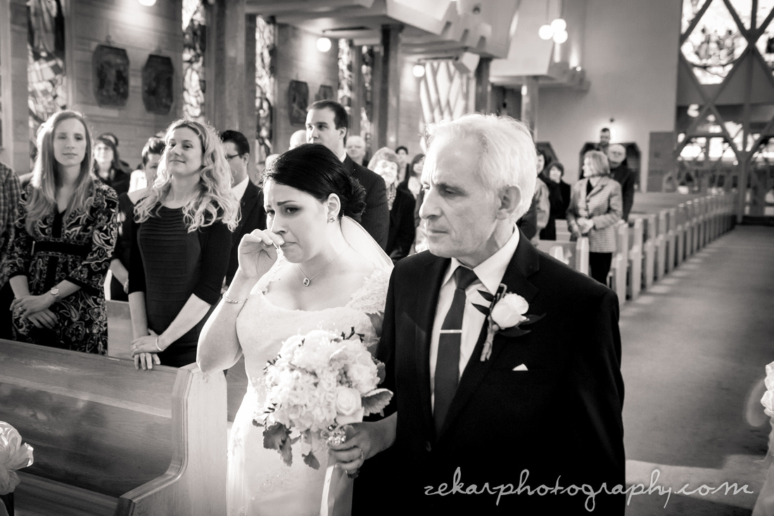 emotional picture of bride walking down the aisle with dad