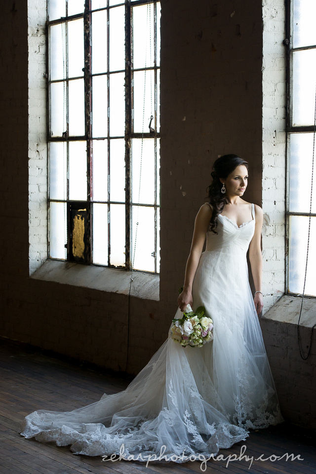 bride standing by old window