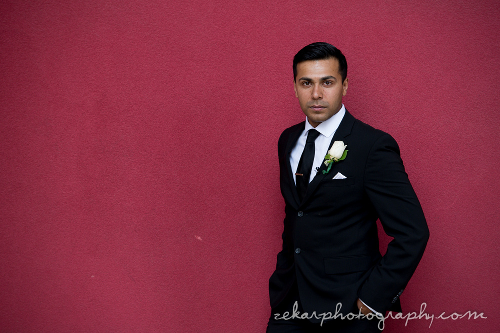 groom on red background