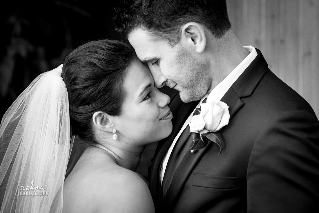 bride and groom snuggling black and white