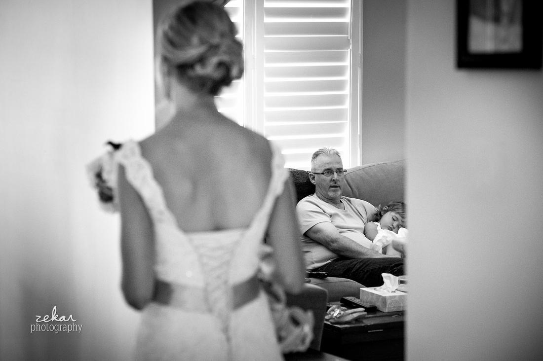 bride walking past dad