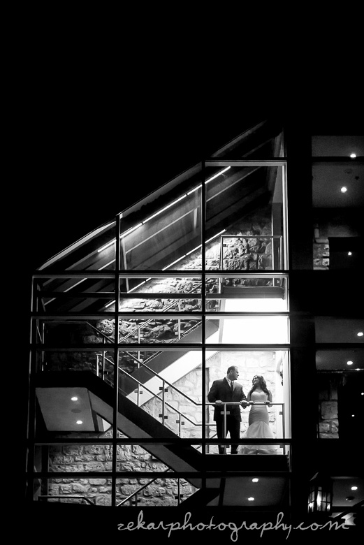 black and white bride and groom in stairwell