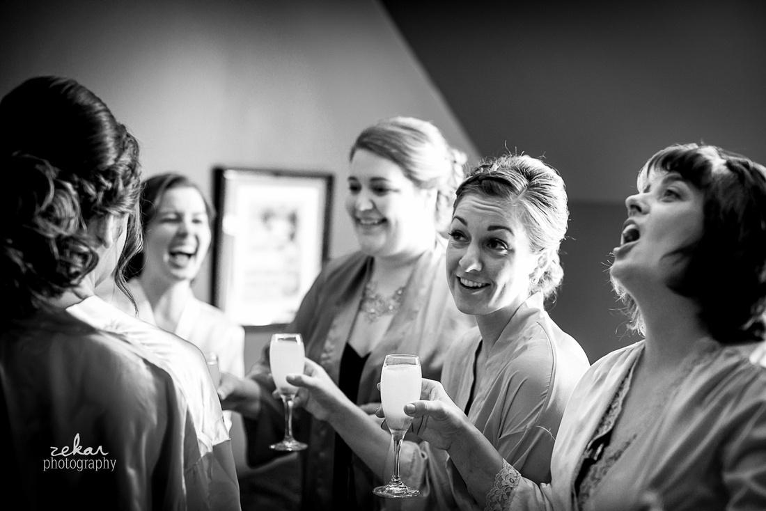 bridesmaids enjoying champagne