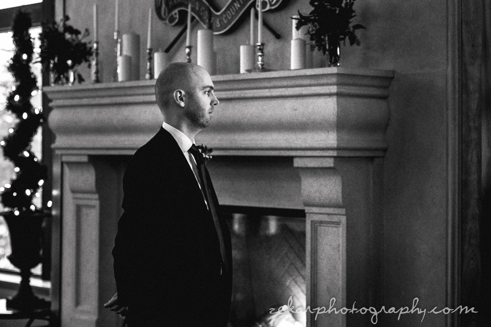 groom waiting by fireplace