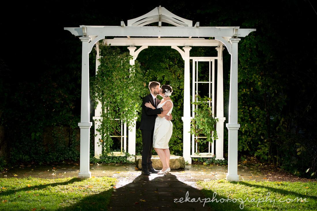 bride and groom kissing under altar