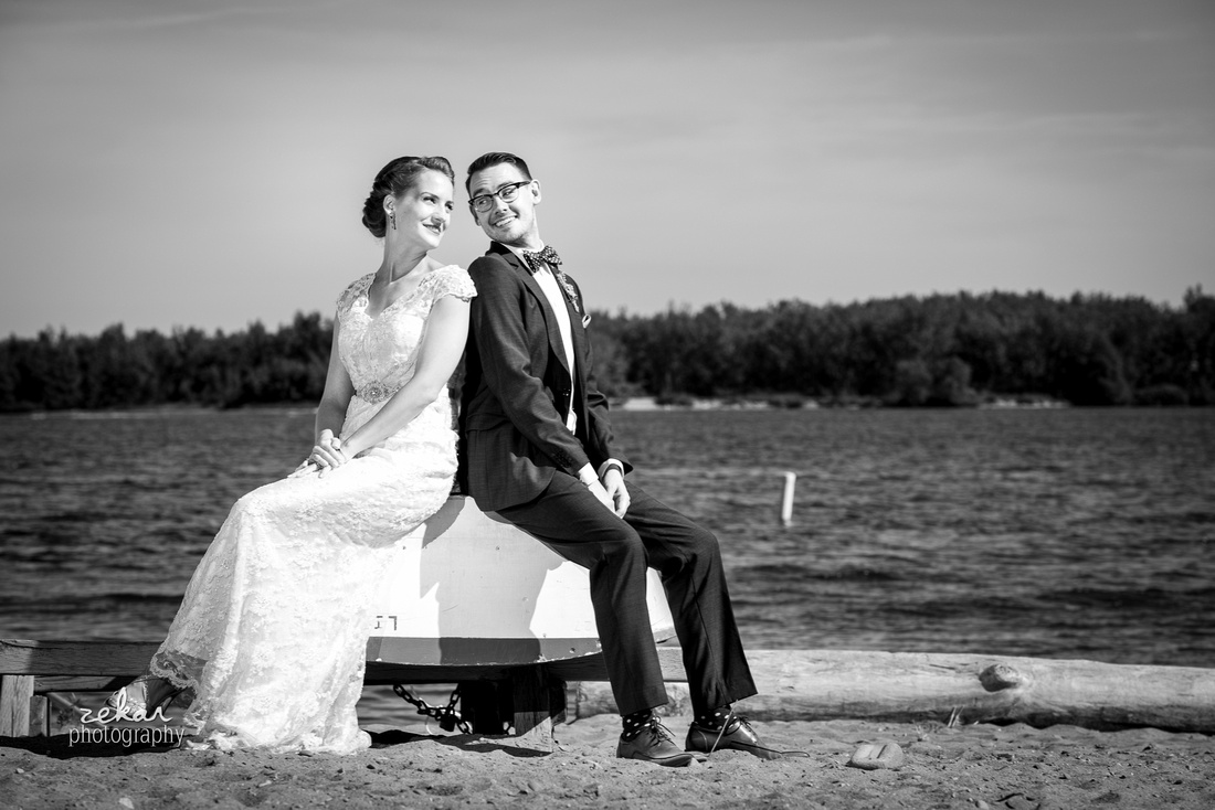 bride and groom sitting on boat