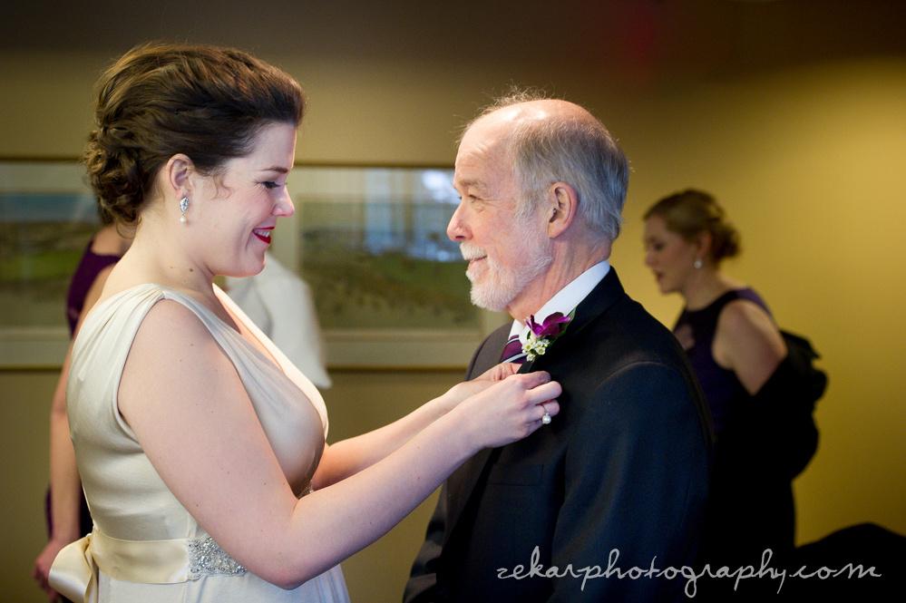 bride pinning flower on dad