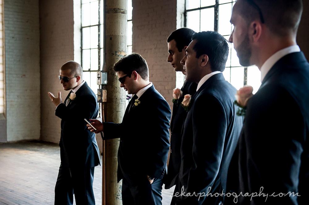 groomsmen watching photography