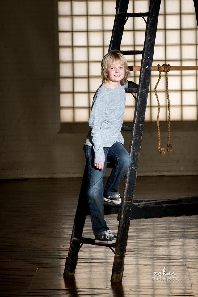boy on antique ladder