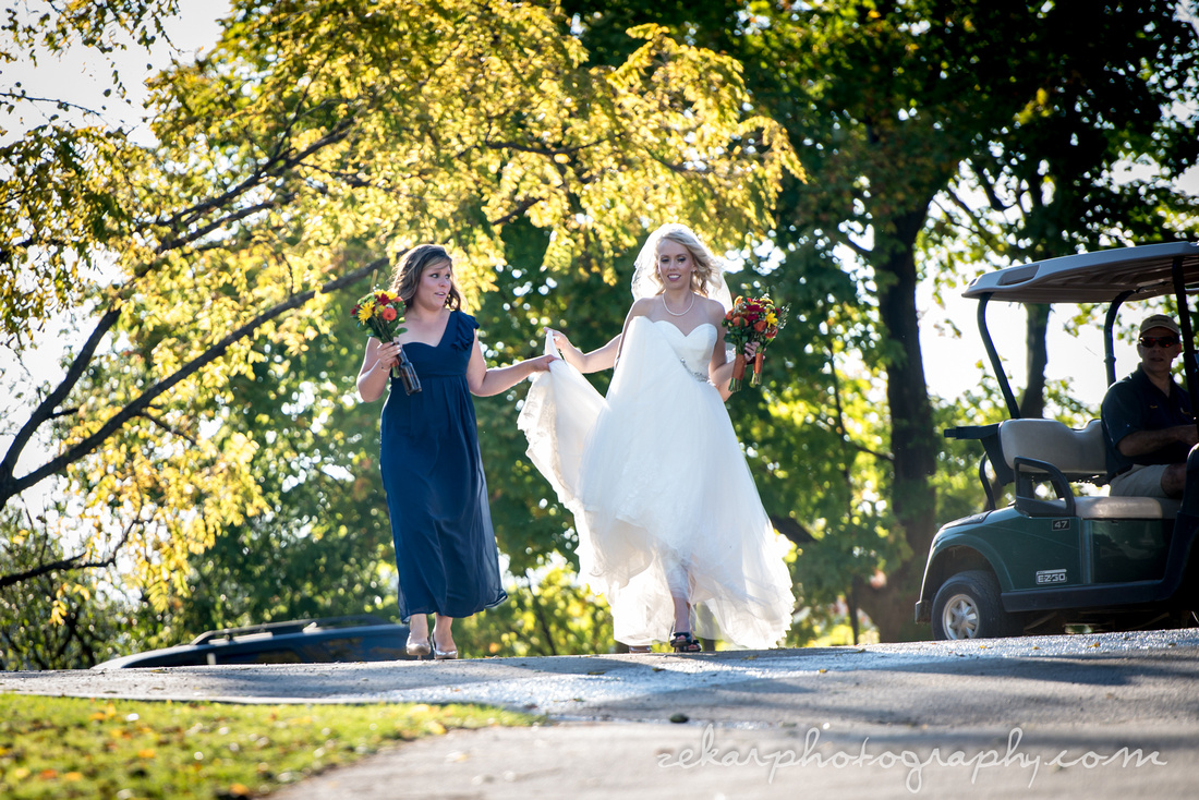 bride walking with maid of honour