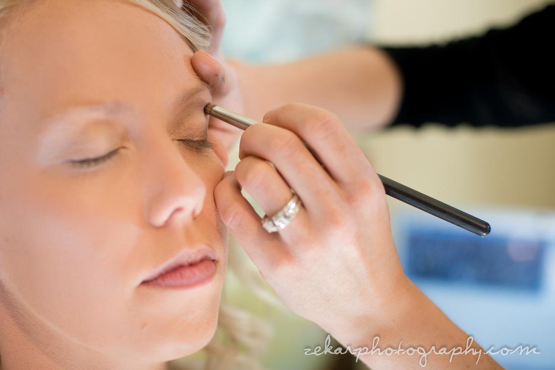 bride getting eyeshadow done