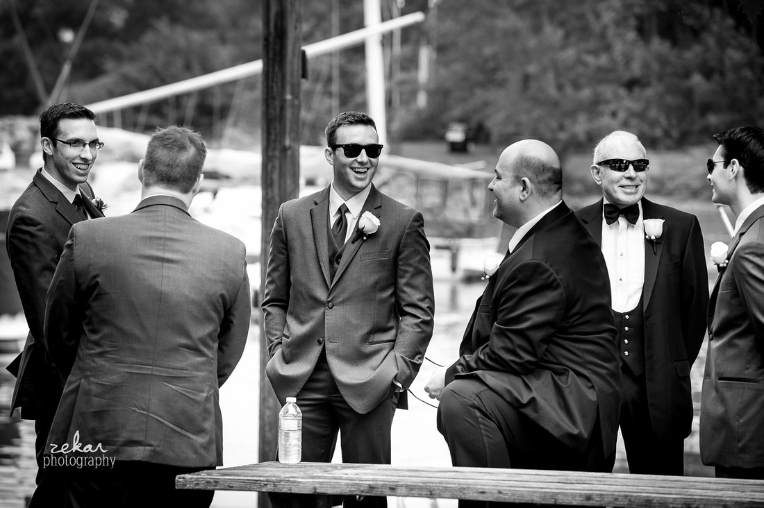 black and white shot of groomsmen waiting