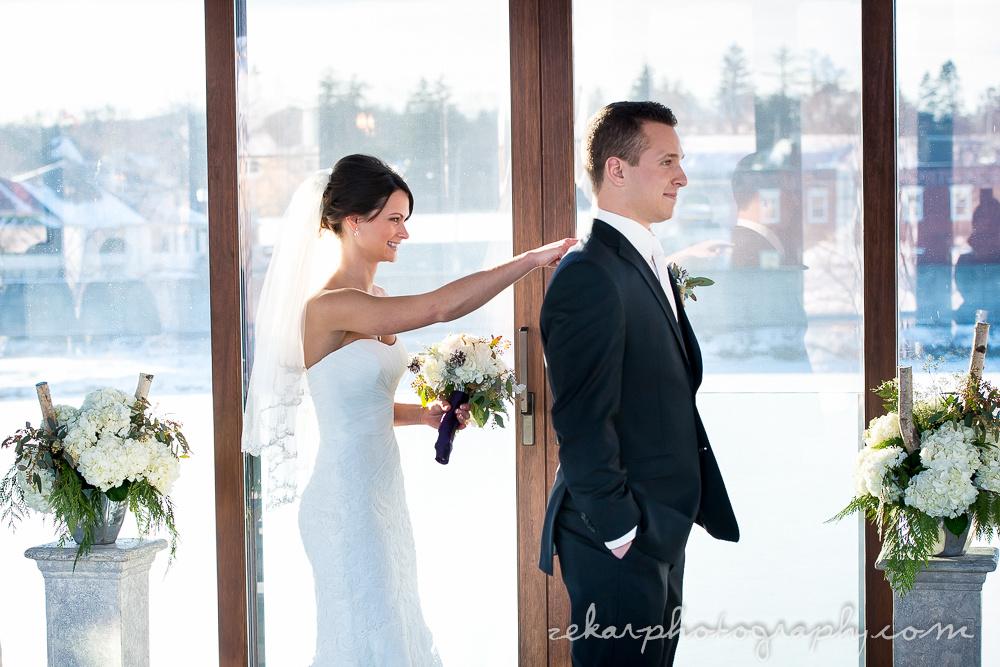 bride touching groom on shoulder