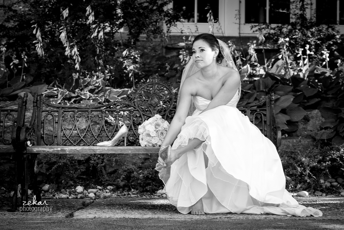 bride taking off shoes