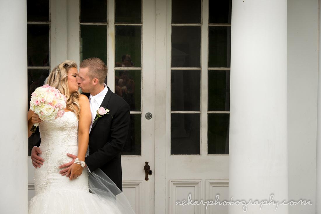 bride and groom kissing at dundurn