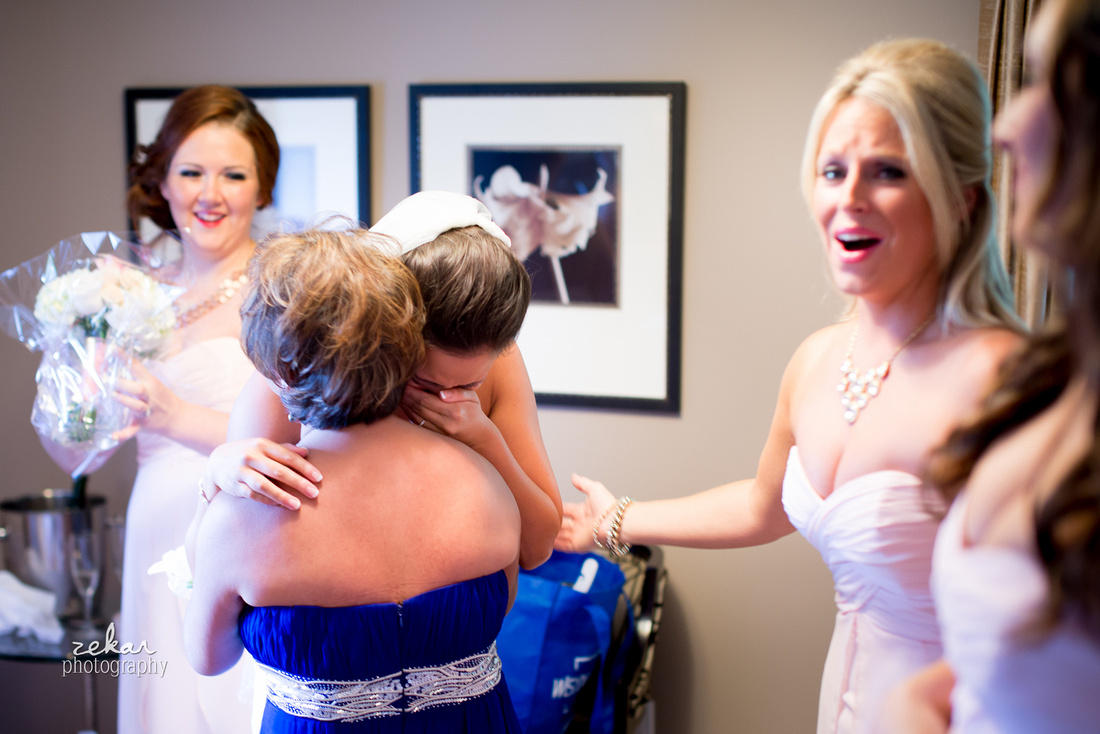 bride crying when she sees her mom