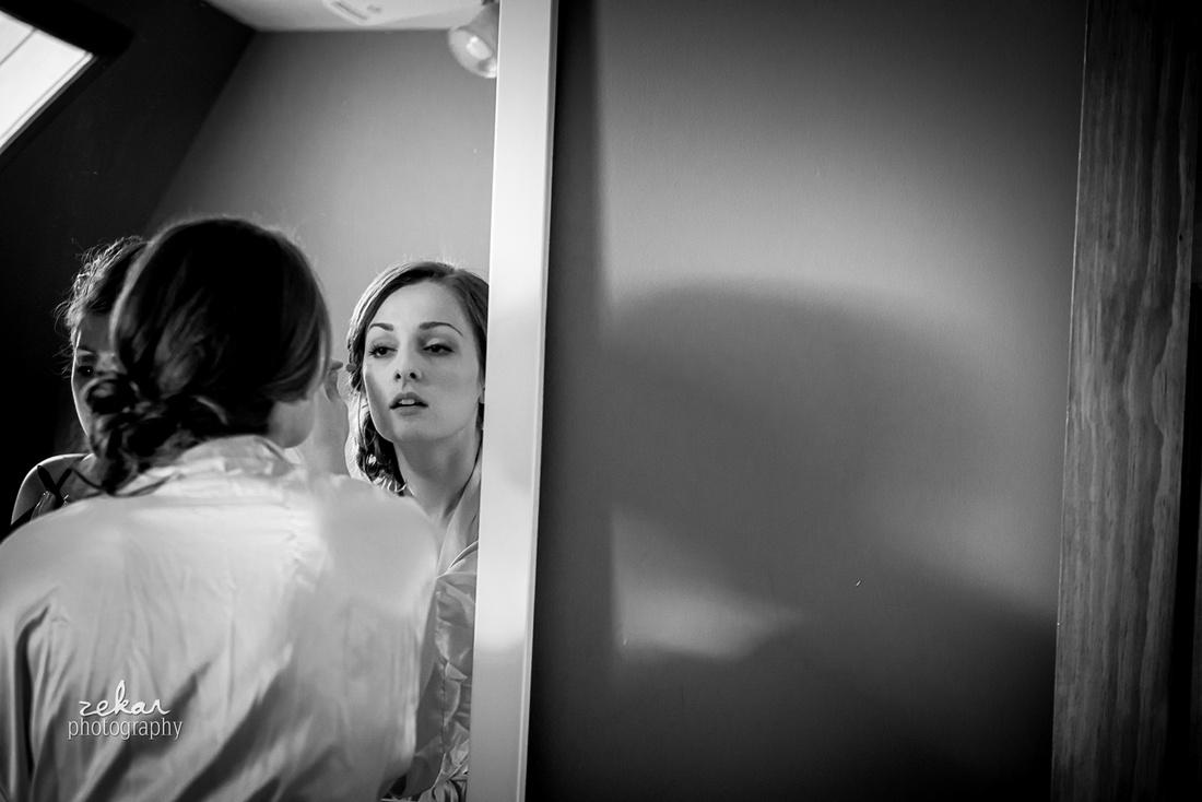 bridesmaid putting makeup on