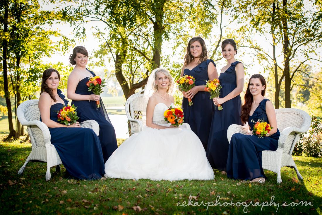bridal party posing in sunlight